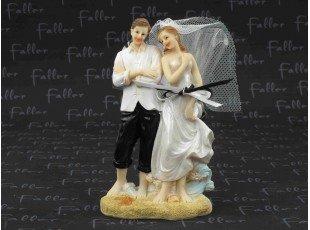 Dragées avec couple de mariés sur le sable