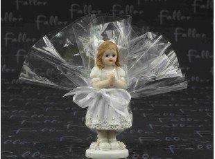 Petite figurine communiante et pochon de dragees