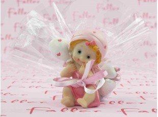Figurine bébé rose et son pochon de dragées baptême fille