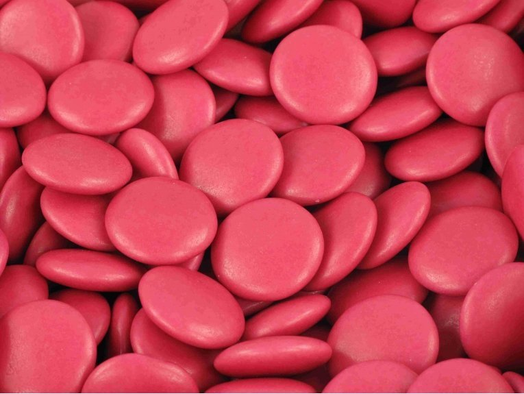 Sachet de dragées confettis chocolat fuchsia de 500 gr