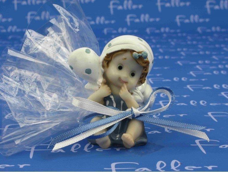 Figurine baptême fille assise avec ballon à pois et dragées