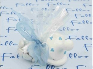 Tétine blanche à cœurs bleus avec dragées garçon