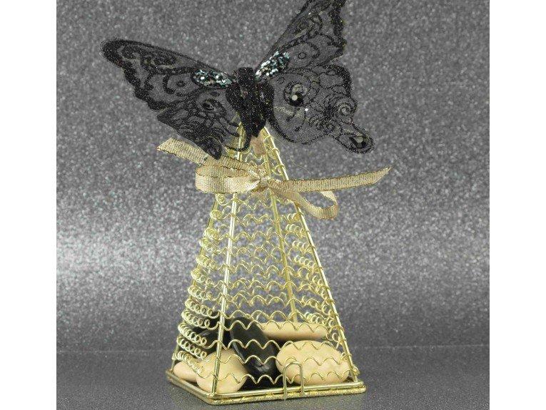 Pyramide dorée, papillon noir et dragées