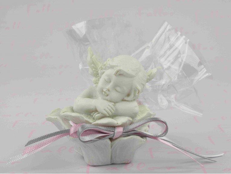 Ange dans rose avec dragées de baptême