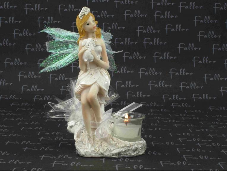 Grande elfe blanche avec ses dragées et sa bougie